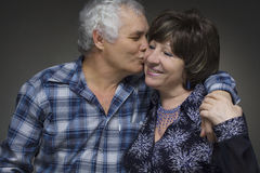 Older couple - love concept. Older couple: elderly men kisses the old women - love concept Royalty Free Stock Photos