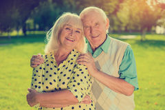 Older couple outdoor. Two people smiling. Happiness given by fate. Let the sun shine brighter Royalty Free Stock Photos