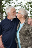 Older couple outside and in love stock images