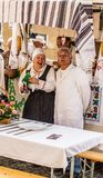 Older couple presenting traditional meals and customs on a Samobor towns day celebration royalty free stock photos
