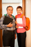 Older couple representing lifelong learning. Couple with school Stock Photography