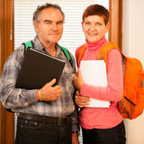 Older couple representing lifelong learning. Couple with school Royalty Free Stock Photos