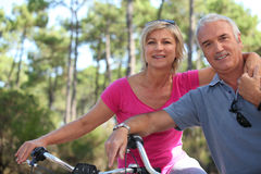 Older couple riding bikes Royalty Free Stock Photo