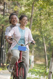Older couple riding tandem bicycle, Beijing royalty free stock photography
