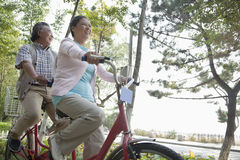 Older couple riding tandem bicycle, Beijing Royalty Free Stock Photo