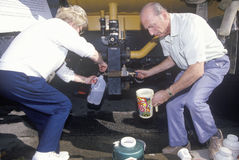 An older couple securing some water from a water. Line after the Northridge earthquake in 1994 Royalty Free Stock Photography