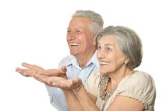 Older couple showing Stock Images