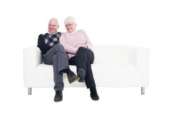 Older couple in a sofa Stock Photo