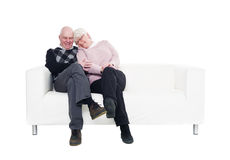 Older couple in a sofa Royalty Free Stock Photos