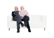 Older couple in a sofa Royalty Free Stock Photo