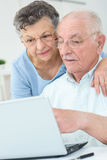 Older couple surfing web. Older couple surfing the web Stock Photography