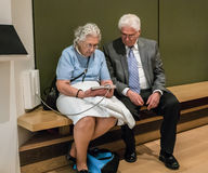 Older couple uses tablet for information at Chicago Art Institut Royalty Free Stock Images