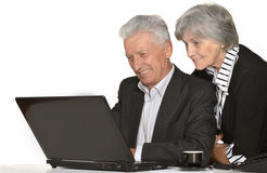 Older couple in the workplace Royalty Free Stock Image