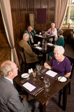 Older couples in restaurant stock image