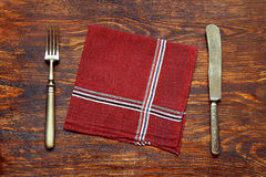Older cutlery with napkin Stock Photography