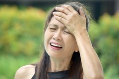 Older Diverse Adult Female Memory Problems. An attractive and asian person royalty free stock photography