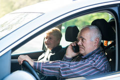 Older driver using smartphone Royalty Free Stock Photography