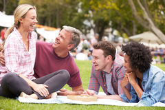 Older Family Relaxing At Outdoor Summer Event Royalty Free Stock Photo