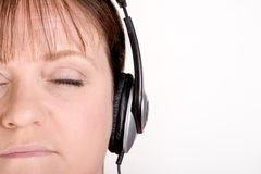 Older female listening to music on headphones Stock Photography