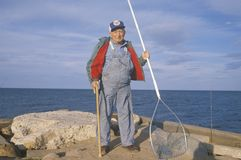 Older Fisherman with net, stock photo