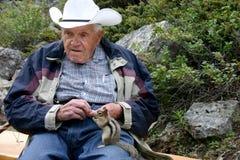 Older gentleman feeding chipmunk. Elderly gentleman feeding a wild chipmunk Stock Photo