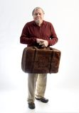 An older gentleman wearing khakis and a sweater holding an antiq Stock Photography