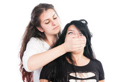 Older girl bullying her younger friend Royalty Free Stock Images