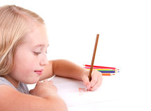 Older girl or teen drawing a bird. With colored pencils Royalty Free Stock Photography