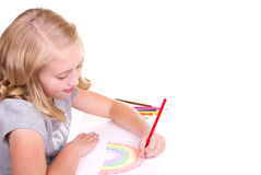 Older girl or teen drawing a rainbow. With colored pencils Royalty Free Stock Photos