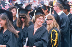 An older graduate smiles Stock Photo