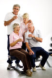 Older group of friends in the gym. Group of older friends taking time out in the gym Royalty Free Stock Images