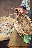 Older hands making a wicker basket Stock Photography