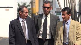 Older Hispanic Business Men Walking. To Work Royalty Free Stock Image