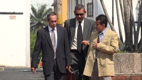 Older Hispanic Business People. Stock photo of business men royalty free stock image