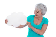 Older isolated woman holding a white sign in her hands. Royalty Free Stock Image