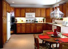 Older Kitchen. With wooden cabinets Stock Photos