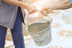 Older Labor or workers carrying construction sand for mix with cement and building houses Stock Photography