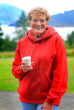 Older lady with drink cup Stock Photography