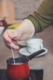 Older lady making coffee Stock Photography