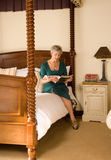 Older lady reading magazine Stock Images