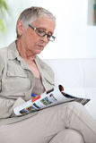 Older lady reading magazine Royalty Free Stock Image