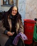 Older lady sell socks in Sighetu Marmației Stock Photo