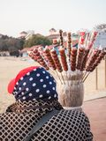 Older lady selling candied fruit on a stick on a beach stock photos