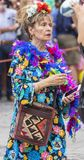 2018: Older lady wearing colorful feathers attending Gay Pride parade also known as Christopher Street Day CSD in Munich. Germany stock photography