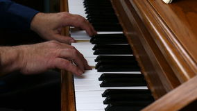 Older Male Hands Playing Slowly On Piano. Older Male Hands Playing Upright Piano Two Hands stock footage