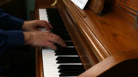 Older Male Hands Playing Upright Piano From Side stock video