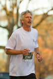 Older male participating in a 5k run Stock Image