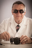 Senior Technician Repairng Camera Royalty Free Stock Photos