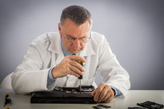 Senior Technician Fixing Laptop Stock Images