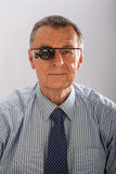 Man with Magnifying Glasses Royalty Free Stock Images